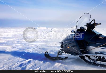 Snowmobile stock photo, A snowmobile on a barren winter landscape by Tyler Olson