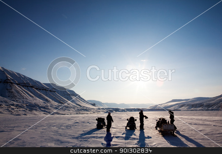 Winter Adventure Landscape stock photo, Three people on a winter snowmobile adventure in Svalbard, Norway by Tyler Olson