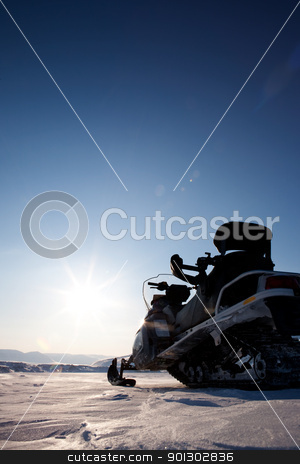 Snowmobile stock photo, A snowmobile detail on a barren winter landscape by Tyler Olson