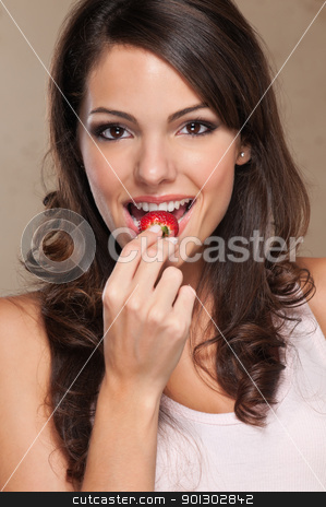 Woman eating strawberry stock photo, Close-up portrait of a cute female eating a fresh strawberry by Tyler Olson