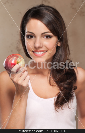 Smiling woman holding apple stock photo, Close-up portrait of young beautiful woman holding an apple by Tyler Olson
