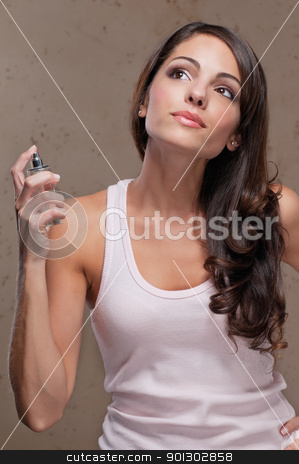 Woman spraying perfume stock photo, An attractive female spraying perfume on herself by Tyler Olson