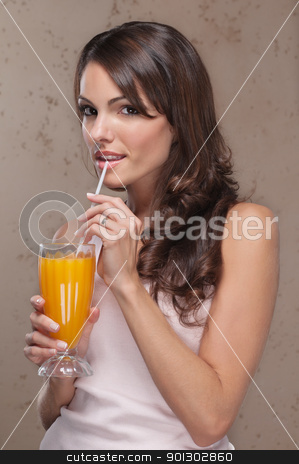 Portrait of woman drinking orange juice stock photo, Smiling portrait of an attractive woman drinking orange juice by Tyler Olson