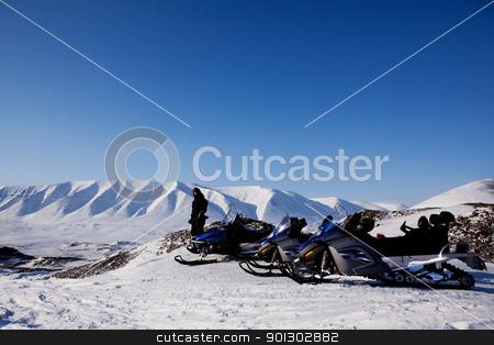 Winter Landscape stock photo, Snowmobiles in a barren winter landscape, Svalbard, Norway by Tyler Olson