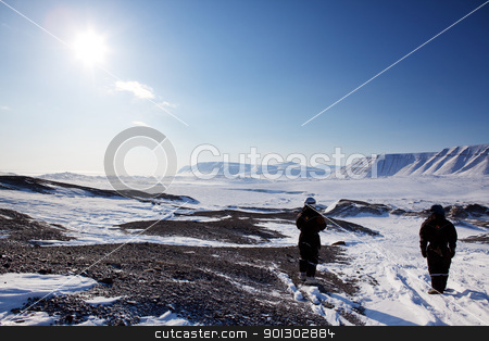 Barren Winter Landscape stock photo, A cold and barren winter landscape in Svalbard, Norway by Tyler Olson