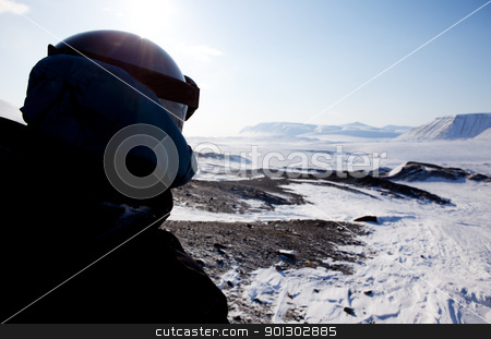 Adventure Guide stock photo, A winter adventure guide on a barren winter landscape by Tyler Olson