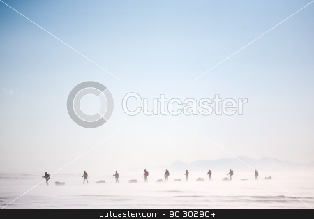 Winter Wilderness Adventure stock photo, A group of people on a winter expedition in a snow storm by Tyler Olson