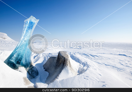 Glacier stock photo, A piece of glacial ice sticking out of the frozen ocean, Spitsbergen, Svalbard, Norway by Tyler Olson