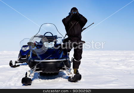 Expedition Guide stock photo, An expedition guide and a couple of snowmobiles on a winter landscape by Tyler Olson