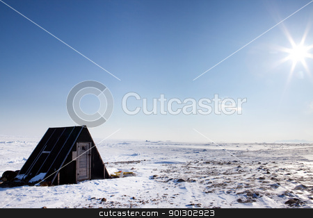Winter Shelter stock photo, A small winter shelter on the frozen coast of Spitsbergen Island, Svalbard, Norway by Tyler Olson