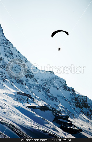 Paraglider over Mountain stock photo, A paraglider travelling over a rocky mountain by Tyler Olson
