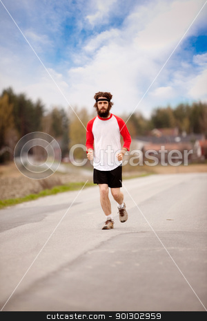 Jogging Man stock photo, A retro style running in the country on a road by Tyler Olson