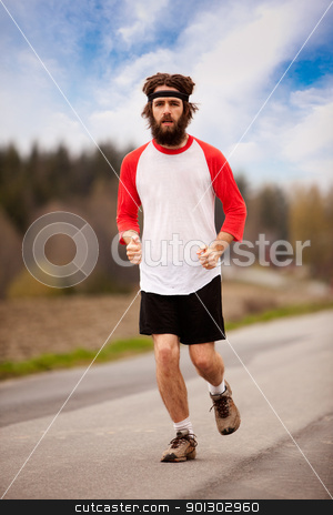 Tired Jogger stock photo, A tired retro style jogger running on a road outdoors by Tyler Olson