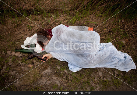 Drunk Homeless Man stock photo, A drunk homeless man sleeping in a ditch by Tyler Olson