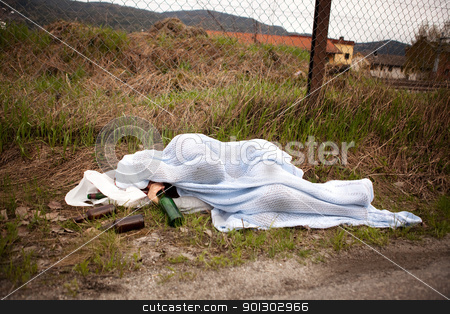 Homeless Person stock photo, A homeless drunk person sleeping in the ditch by Tyler Olson