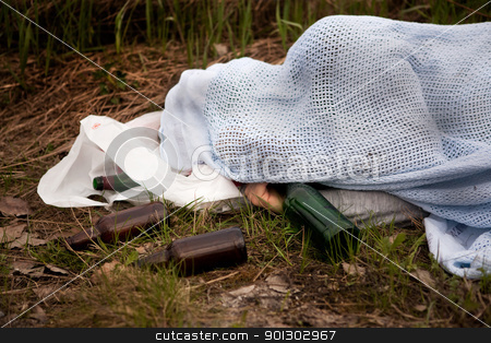 Homeless Drunk stock photo, A homeless man with a number of beer bottles by Tyler Olson