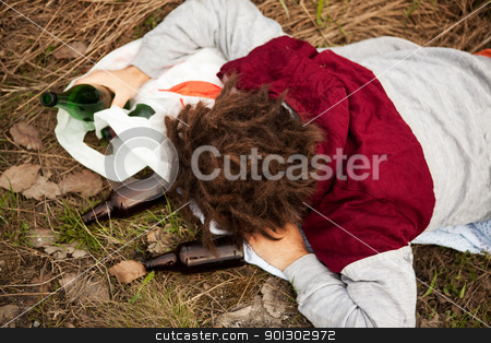 Alcoholic stock photo, A homeless person sleeping in the ditch by Tyler Olson
