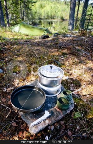 Camp Stove stock photo, A camp stove set up in nature, ready for a meal by Tyler Olson