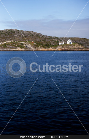 Norway Coast stock photo, A small house on the coast of Norway by Tyler Olson