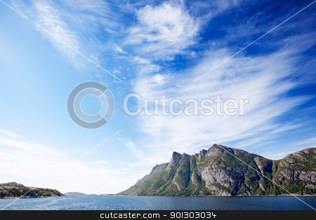 Mountain Coast stock photo, Mountains on a coastal landscape in northern Norway by Tyler Olson