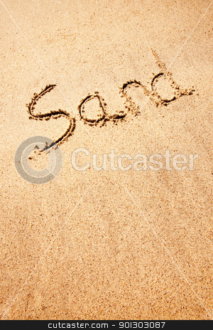 Sand stock photo, A sand background image with the word written with a stick by Tyler Olson