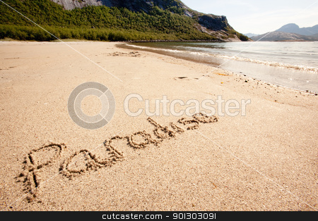 Paradise Island stock photo, The word paradise written in the sand on a beautiful island by Tyler Olson