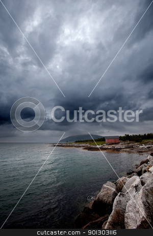 Sea Storm stock photo, A brewing storm on an ocean sunset by Tyler Olson
