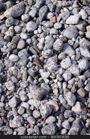 Pebble Background stock photo, A surface texture of coastal small rocks - background surface by Tyler Olson