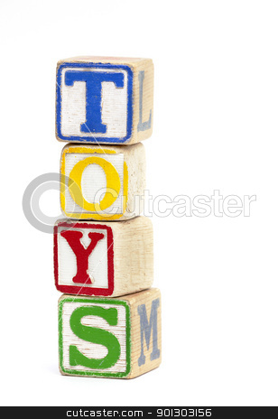 Toys stock photo, Wooden toy block stacked up to spell the word 'Toys' by Tyler Olson