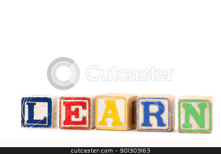Spell Learn stock photo, The word learn with wooden baby blocks by Tyler Olson