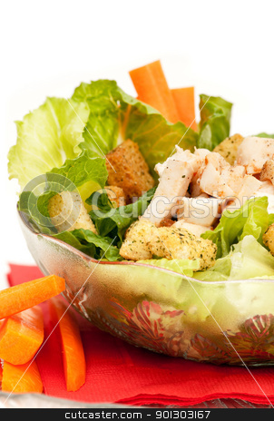 Chicken Caesar Salad stock photo, A bowl of chicken Caesar salad isolated on white by Tyler Olson