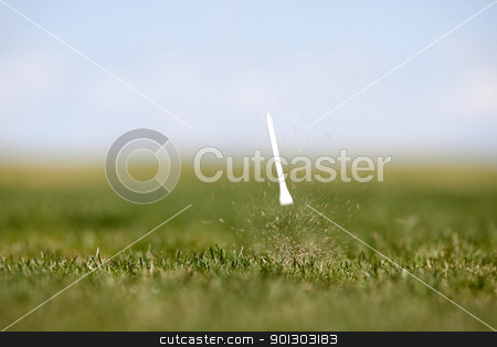 Golf Swing stock photo, The after effects of a golf swing.  Shallow depth of field with motion blur on Tee by Tyler Olson