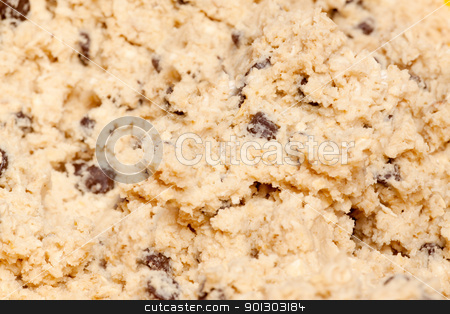 Cookie Dough stock photo, A cookie dough detail with wood spoon by Tyler Olson