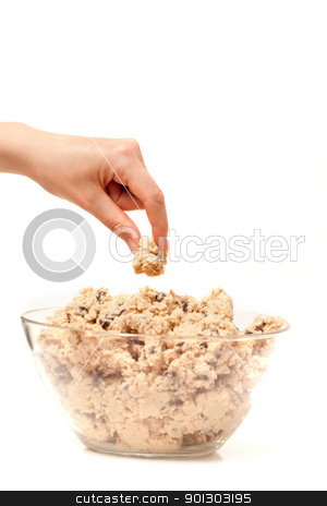Cookie Dough Taste Test stock photo, A hand sneaking a taste test of cookie dough. by Tyler Olson