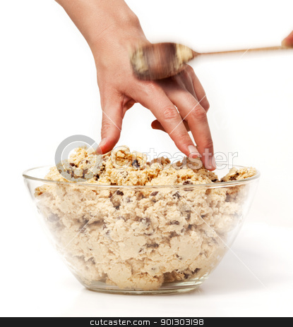 Sneak Cookie Dough stock photo, A hand reaching for cookie dough and getting caught by Tyler Olson