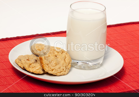 Christmas Snack stock photo, Milk and cookies - a typical christmas snack by Tyler Olson