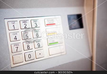 Bank Machine stock photo, A close up detail of an outdoor bank machine; shallow depth of field with critical focus on middle row of numbers by Tyler Olson