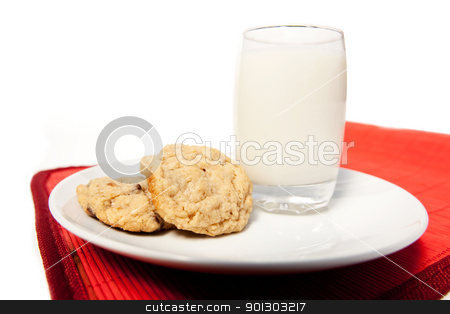 Milk and Cookies stock photo, A plate of chocolate chip cookies and a tall glass of milk by Tyler Olson
