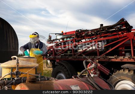 Working with Chemical stock photo, Filling a high clearance spraying with chemical and water by Tyler Olson