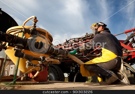 Chemical Safety stock photo, A man filling a high clearance sparying with good chemical safety by Tyler Olson