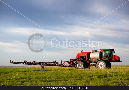 High Clearance Sprayer stock photo, A high clearance sprayer on a field  in a prairie landscape by Tyler Olson