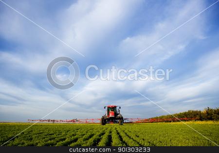 High Clearance Sprayer stock photo, A high clearance sprayer on a field  in a prairie landscape by Tyler Olson