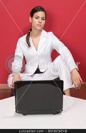 Smart businesswoman posing stock photo, Portrait of smart businesswoman posing in front of laptop on table by Tyler Olson