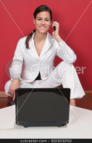 Smart young executive using cell phone stock photo, Smart business woman holding cell phone and smiling by Tyler Olson