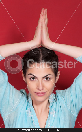 Young pretty woman doing yoga exercise stock photo, Portrait of young pretty woman doing yoga exercise by Tyler Olson