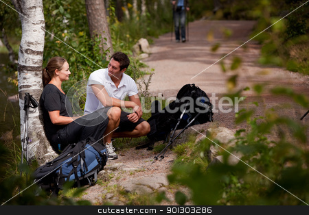 Hiking Break stock photo, A couple take a break while backpacking on a prepared trail by Tyler Olson