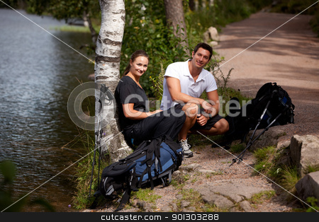 Camping Couple stock photo, A couple taking a break while on a hiking camping trip by Tyler Olson