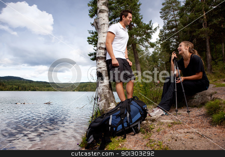 Camping stock photo, A couple on a camping trip - taking a break by a lake by Tyler Olson