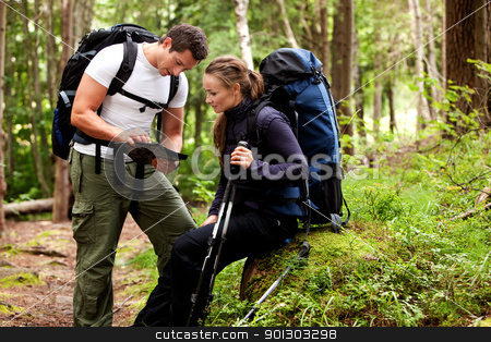 Map Camping  stock photo, A couple of backpackers looking at a map in the forest by Tyler Olson