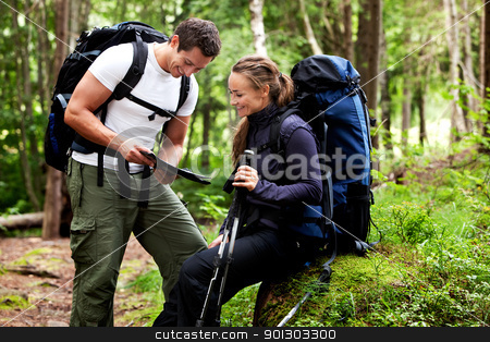 Map Forest Camping stock photo, A couple with smiles looking at a map in the forest  by Tyler Olson